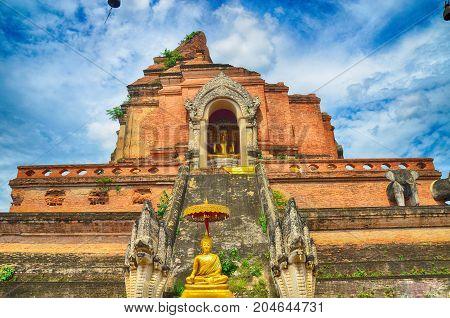 Wat Chedi Luang and Buddha statue in Chiangmai Thailand