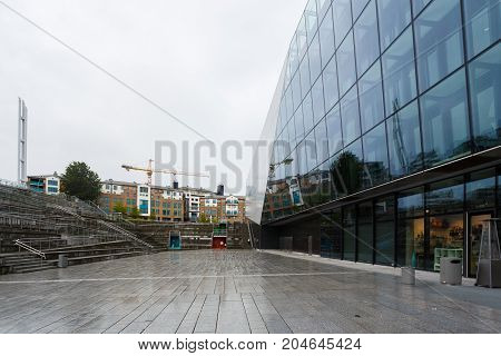 Stavanger Norway - August 24 2017: Glass exterior of the Stavanger Concert Hall in rainy weather