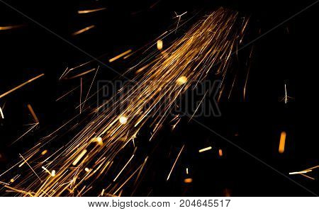 Sparks from metal on construction site as background .