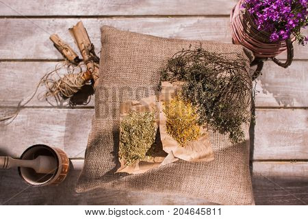 Medicine. Flower ingredients with natural herb. Homemade alternative medical drug, pharmaceutics homeopathy, herbal tea preparation top view