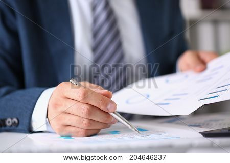 Male Hands Hold Documents With Financial Statistics