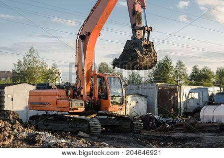 Excavator on construction site. Road repair. Pipe laying.