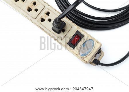 Old and not safe power strip with illuminated switch isolated on white background