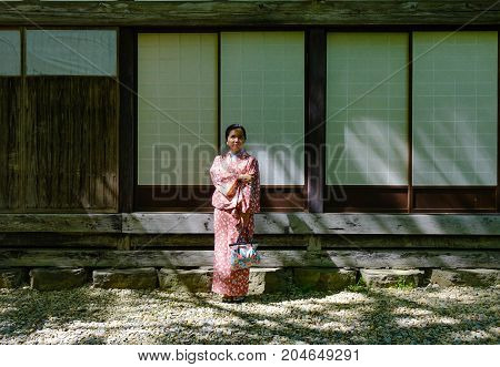 A Woman In Kimono At Old Village In Japan