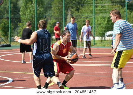 Orenburg, Russia - July 30, 2017 Year: Men Play Street Basketball