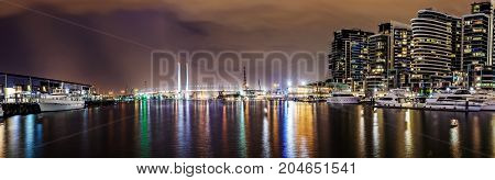 Panorama view of a beautiful view of docklands and The Bolte Bridge at night in Melbourne Australia.