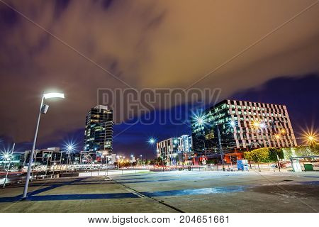 a beautiful view of Melbourne city around dockland with a cloudy sky and twilight in Melbourne Australia.