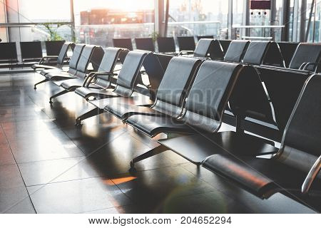 Close-up void benches situating in extensive airport room. Design concept