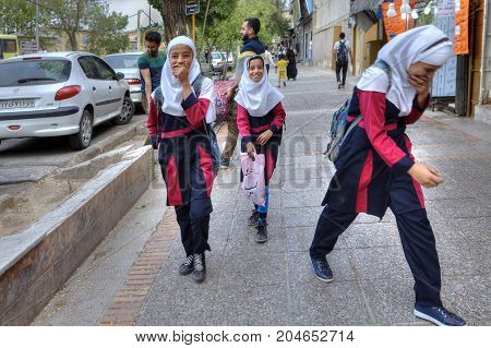 Fars Province Shiraz Iran - 18 april 2017: Merry Iranian schoolgirls in school uniforms return home after school hours.