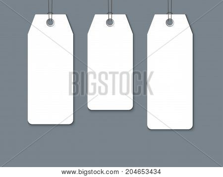 Blank paper label or cloth tag set isolated on dark background. Composition for promo and sale design