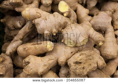 heap of ginger root Ginger background A bunch of ginger on the counter of a vegetable supermarket for sale top view