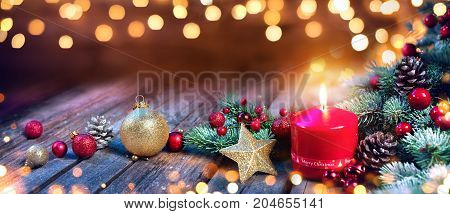Advent Candle With Christmas Decorations On Vintage Wood
