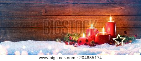 Advent Season - Four Red Candles On Snow With Vintage Wood