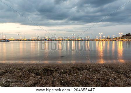 CHERNOMORETS, BULGARIA - AUGUST 15, 2017: Night seascape of port and beach of Chernomorets, Burgas region, Bulgaria