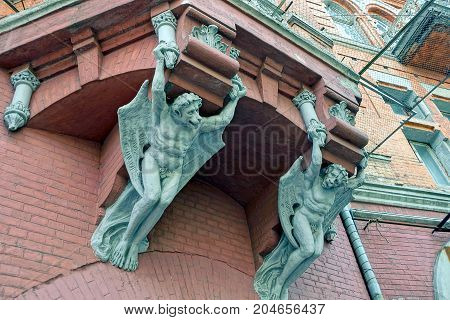 part of the old balcony on the wall with sculptures