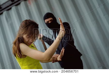 Bandit man belt for attack injure woman scary and rape violence concept