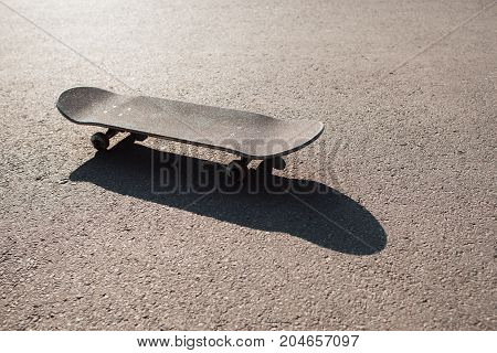 One skateboard on the road. Extreme sport challenge and skateboarder competition, short break after skate exercise