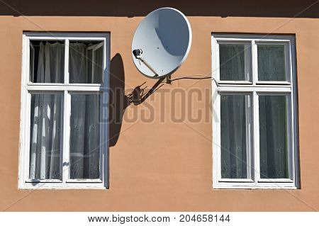 Windows and satellite dish on the wall