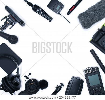 Compisition with field audio recorder card case windsheild and shotgun microphone and other stuff