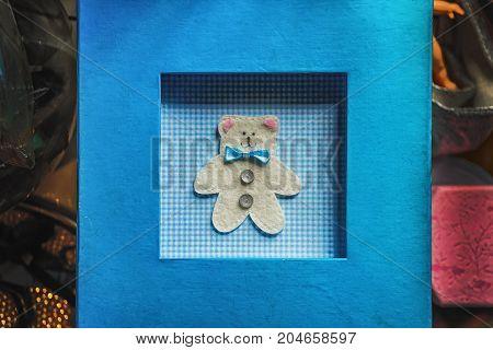 Handmade blue postcard with white teaddy bear.