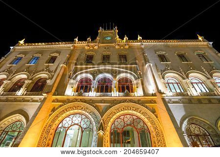 Lisbon, Portugal - August 24, 2017: spectacular manueline facade of Rossio Railway Station illuminated at night in Rossio Square, Lisbon, Portugal, Europe. Architecture background. Urban night scene