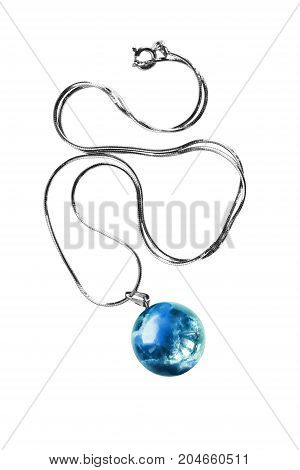 Blue ball aquamarine pendant on a chain isolated over white