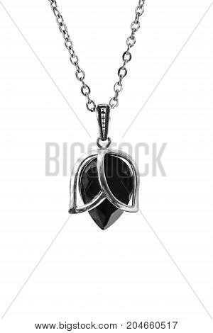 Black crystal pendant on silver chain on white background