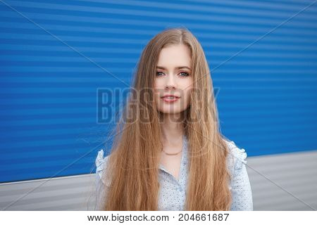 Emotional Close Up Portrait Of A Adult Pretty Blonde Woman With Gorgeous Extra Long Hair Posing Outd
