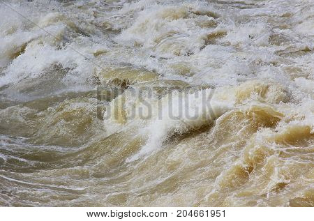overflowing river with extremely dangerous rapids and wild water