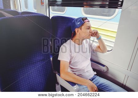 Young Man Rides A Train, Looks Out The Window, Travel, Comfortable Trip Trip