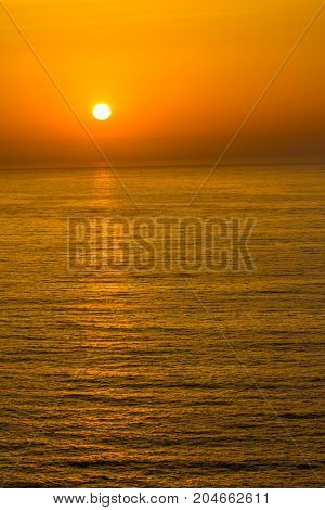 Sunset In The Ocean In Arrifana