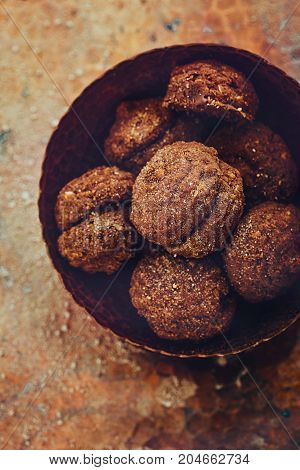 Chocolate truffles. Vintage food dessert with cocoa and nuts