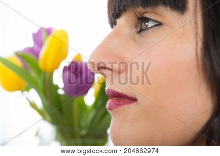 a portrait of beautiful brunette girl side view
