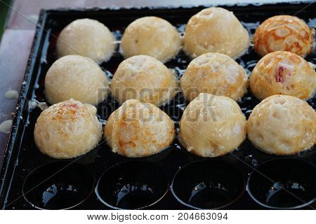 Takoyaki is delicious Japanese food on pan