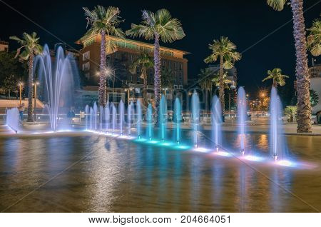 ALBANIA DURRES - September 22 2015: Evening central square with fountains colorful illumination