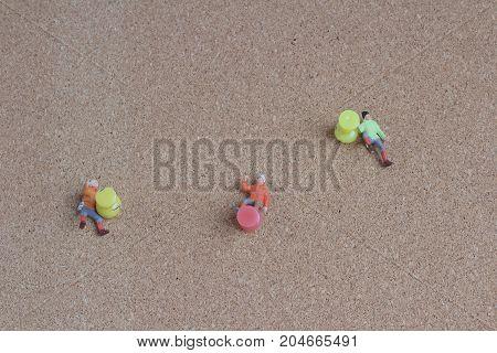 Little Figure Climb The Pin At Board