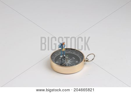 Fun Of Min Figure Standing On Compass