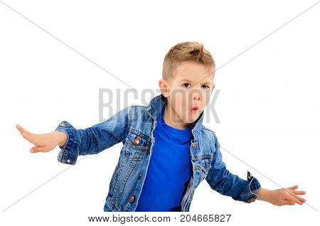 Portrait of a stylish dancing boy in a jeans jacket, isolated on a white background