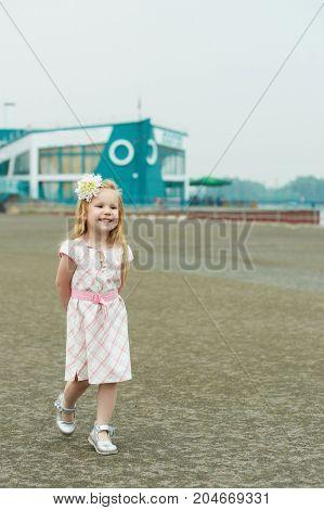 Girl in a dress. Summer walk outdoos