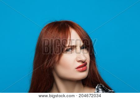 Confused girl portrait. Distrustful woman. Gloomy young lady, suspicious emotion concept