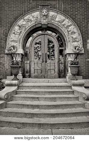 Entrance to a Renaissance style building in black and white