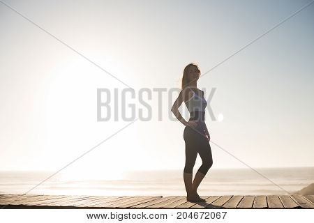 Fit Woman Enjoying Sunset On The Beach