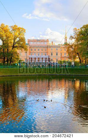 ST PETERSBURG RUSSIA-OCTOBER 3 2016. Michael Castle or Engineers Castle in St Petersburg Russia and Karpiev pond in Summer garden. Autumn city landscape of St Petersburg Russia