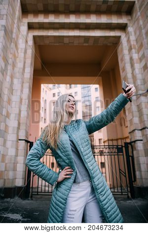Modern technology. Girl take selfie on street, social media in everyday life