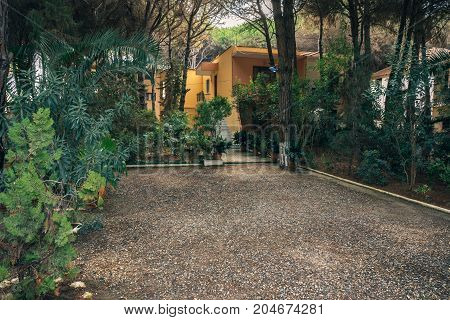 ALBANIA GOLEM- September 20 2015: House on the Adriatic Sea in a mixed forest with tropical plants. Property rental in a resort.