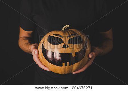 Man With Pumpkin For Halloween In Hands