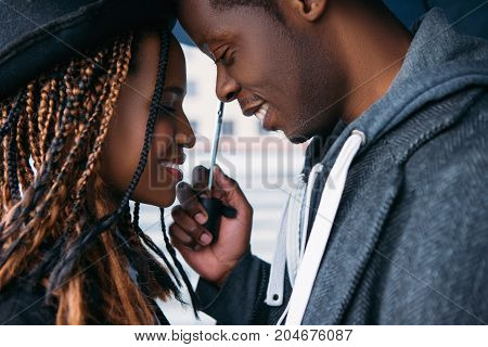 Romantic date. African American love couple. Happy relationship, smiling black people on rainy day, happiness concept