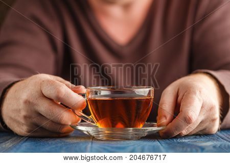 Male Hold Cup Of Hot Tea