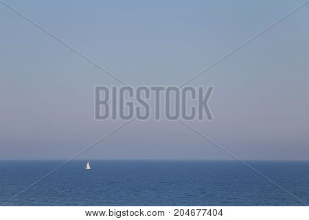 Lonely white sailboat navigating on Black Sea