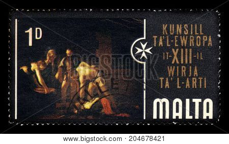 Malta - CIRCA 1970: A stamp printed in Malta shows the beheading of Saint John the Baptist is an oil painting by the Italian artist Caravaggio in St John's Co-Cathedral Malta, circa 1970